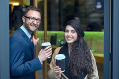 Two business colleagues purchasing takeaway coffee Stock Image