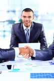 Two business colleagues shaking hands Royalty Free Stock Images