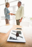 Two business colleagues shaking hands Stock Photos