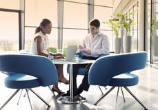 Two business colleagues sitting at a table, having a meeting Stock Image