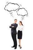 Two business colleagues with thinking clouds Stock Photos