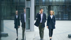Two business colleagues walking outside office stock video