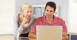 Two business colleagues working at desk Stock Images