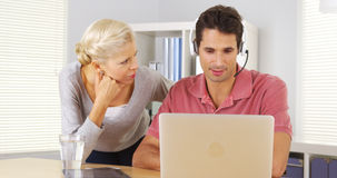 Two business colleagues working at desk Royalty Free Stock Image