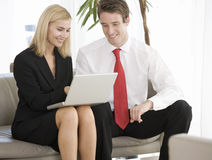 Two business colleagues working on a laptop Stock Photography