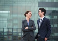 Two business collegues smiling outdoors in the city Stock Photo