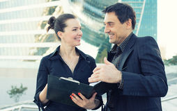 Two business collegues talking and laughing Royalty Free Stock Photo