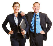 Two business consultants as team. In suits with folder Stock Photography