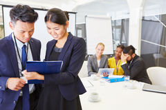 Two business consultants working. With start-up team in workshop Stock Photo