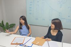 Two business employees talking in the meeting room stock photos