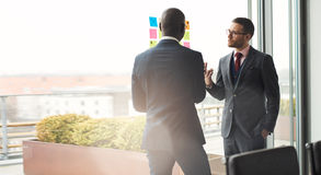 Two business executives in an animated discussion Royalty Free Stock Image