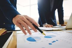Two Business executives partner analysis data document with accountant at office place.  royalty free stock photo