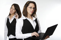 Two business girls Stock Images