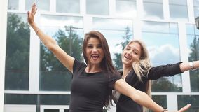 Two business girls feel happiness looking at the camera. Two business girls feel happiness looking at the camera stock footage