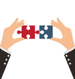 Two Business Hands combining two pieces of puzzle Royalty Free Stock Images