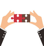 Two Business Hands connect two pieces of puzzle Royalty Free Stock Photos