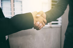 Two Business handshake their agreement to sign contract ,soft fo. Cus and blurry Royalty Free Stock Image