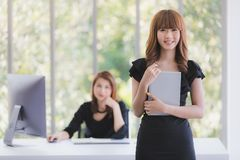 TWO BUSINESS LADIES IN OFFICE royalty free stock images