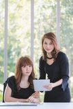 TWO BUSINESS LADIES IN OFFICE royalty free stock photo