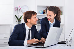 Two business male and female assistants wearing formalwear having work conversation. Two cheerful positive business male and female assistants wearing formalwear stock photos