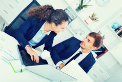 Two business male and female assistants wearing formalwear havin. Two diligent glad  business male and female assistants wearing formalwear having work Stock Photos