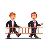 Two business man carrying wooden ladder together Royalty Free Stock Photo