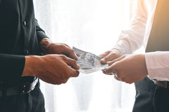 Two business man dealing. Two business men dealing with handing money Royalty Free Stock Images
