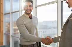 Two Business Man Shake Hand Agreement Coworking Center Business Team Coworkers Stand In Front Big Panoramic Window Stock Photo
