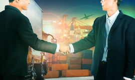 Two business man shaking hand against container truck in shippin Stock Image
