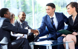 Two business man shaking hands stock photos
