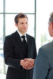 Two Business Man shaking hands Stock Image