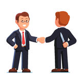 Two business man shaking hands. Betrayal metaphor. Two business man standing shaking hands. Businessman holding knife behind his back. Treacherous deal or Stock Image