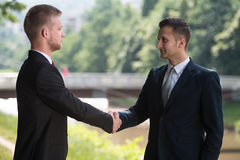 Two Business Man Shaking Hands In Park Royalty Free Stock Photography