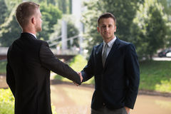 Two Business Man Shaking Hands In Park Stock Photo