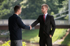 Two Business Man Shaking Hands In Park Stock Image