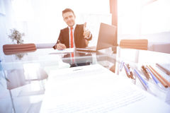 Two business man shaking hands to each other above signed contract Stock Images