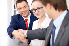 Two business man shaking hands to each other finishing up the meeting Stock Photos