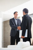 Two business man shaking their hands for a deal Royalty Free Stock Images