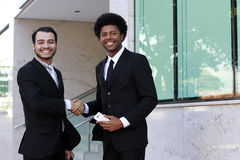 Two business man smiling on work Royalty Free Stock Image