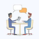 Two Business Man Talking Discussing Chat Box Bubble Communication Sitting at Office Desk Royalty Free Stock Photos