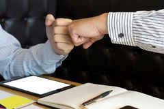 Two business man use hand to fist bump for succes teamwork. Coporate , white tablet screen with clipping path royalty free stock photo