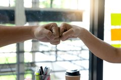 Two business man use hand to fist bump for succes. Teamwork coporate stock image
