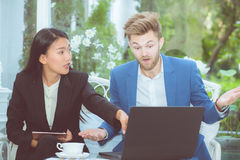Two business man and woman with laptop - tablet pc computer. Royalty Free Stock Photography