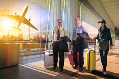 Two business man and woman with traveling luggage walking in air Royalty Free Stock Image