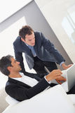 Two business man working out on some solutions Royalty Free Stock Images