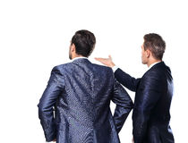 Two business mans from the back. Looking at something over a white background Stock Photo