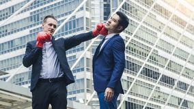 Two business mans are fighting with boxing glove Royalty Free Stock Images