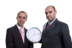 Two business men with clock Stock Images