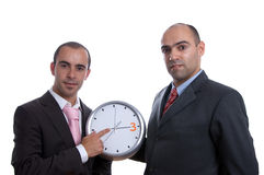 Two business men with clock Royalty Free Stock Photo