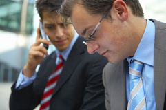 Two business men  concerned. Two young business men looking concerned Royalty Free Stock Images